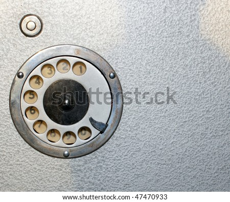 Telephone disk on a metal surface close up