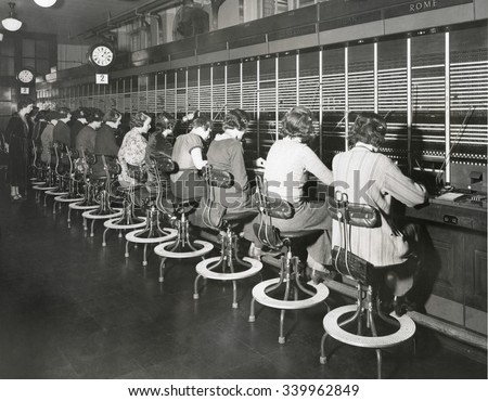 Telephone operators working on an international switchboard in the 1930s