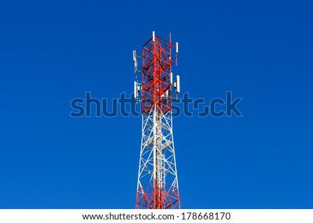 telephone pole telecommunications tower on blue sky background - stock photo