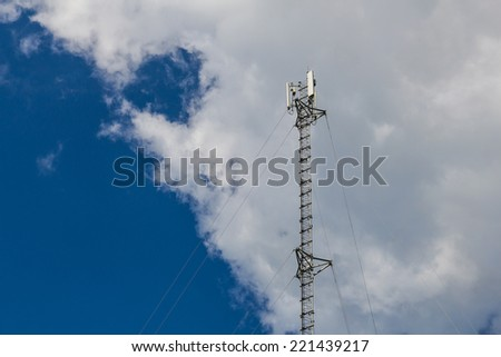 Telephone pole with clear blue sky in a village