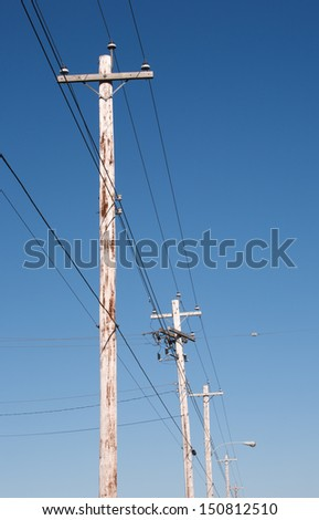 Telephone poles and blue sky - stock photo