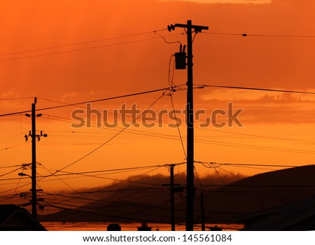 Telephone Poles and Wires at Sunset - stock photo