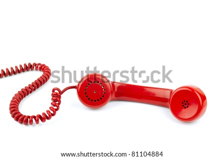 Telephone receiver and cord, isolated on white background - stock photo