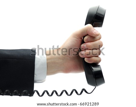 Telephone receiver in businessman's hand - stock photo