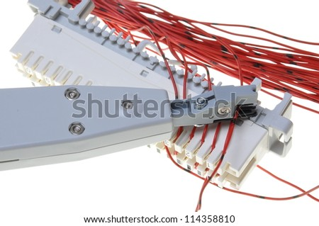 Telephone switchboard panel with punching tool - stock photo