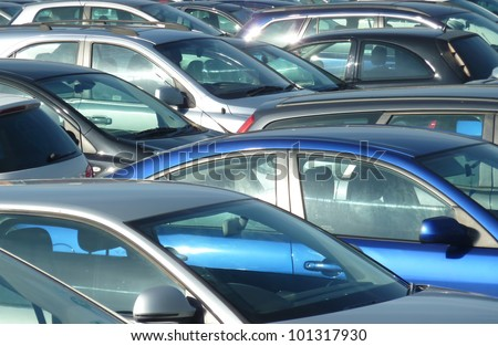Telephoto view of cars parked in Leeds parking lot - stock photo