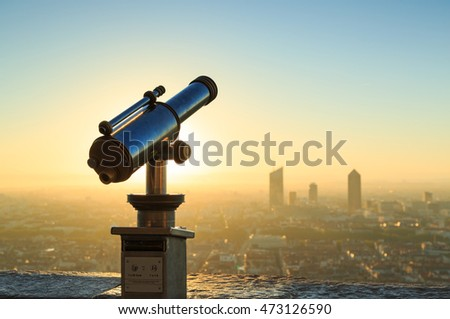 Telescope and panoramic view at Lyon city from Fourviere hill viewpoint. France.