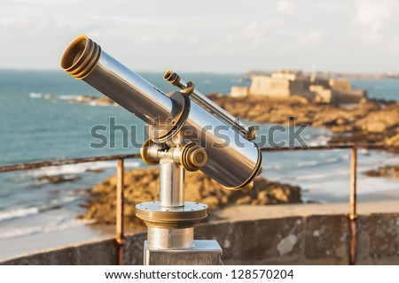 Telescope and View from corsair town of Saint-Malo, Normandy, France--one of the most visited tourist sites in France - stock photo