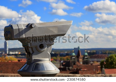Telescope in the Nuremberg castle, view of the city, church, sky, clouds