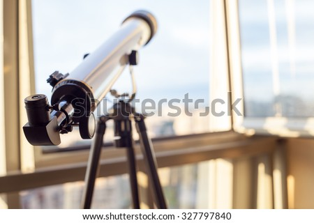 telescope on the balcony, home surveillance, small depth of field - stock photo