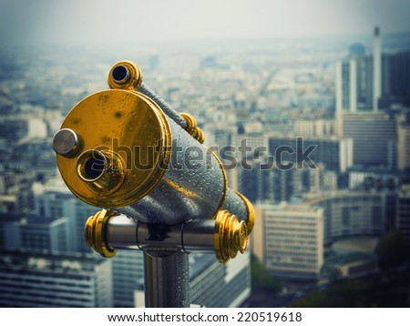 Telescope on top floor of Eiffel Tower in Paris France - stock photo