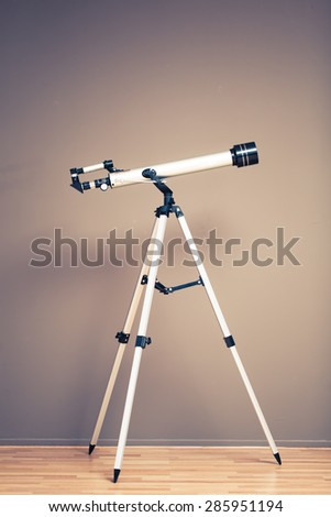 telescope on tripod with copy-space - stock photo