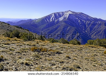 Telescope Peak in the Panamint Range, highest point in Death Valley National Park, California. The peak is a popular mountain to climb even when covered in snow in winter. - stock photo