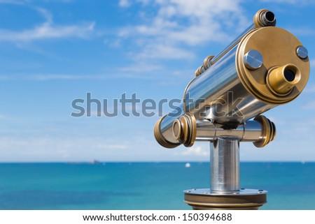 Telescope to observe the coastal landscape - stock photo