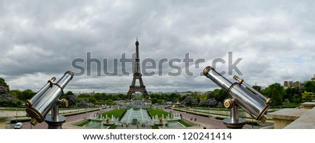 Telescope viewer and Eiffel Tower in Paris, France - stock photo