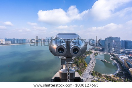 telescope with cityscape in hangzhou