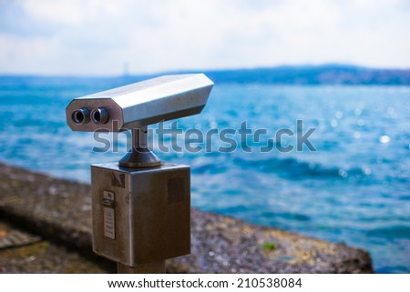 Telescope with coin on an observation deck of the city Istanbul - stock photo
