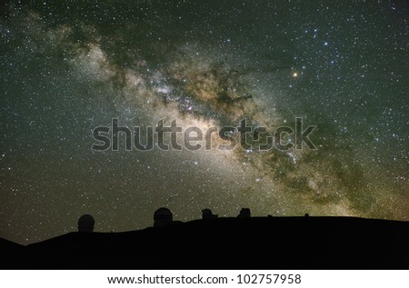 Telescopes observe the Milky Way. These are on Mauna Kea, Hawaii; one of the best astronomical sites in the world. - stock photo