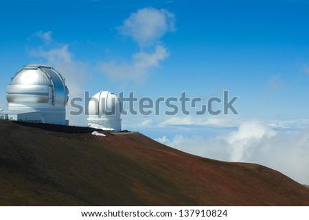 Telescopes on Mauna Kea (Gemini Northern Telescope and Canada-France-Hawaii Telescope) - stock photo