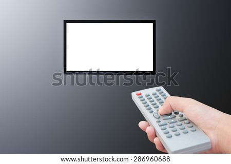 Television and remote control TV on dark background - stock photo