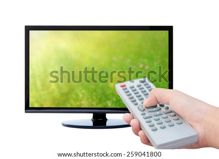 Television and remote control TV on green background - stock photo