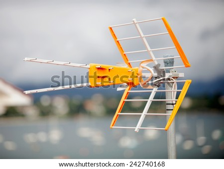 Television antenna on the roof of a house - stock photo