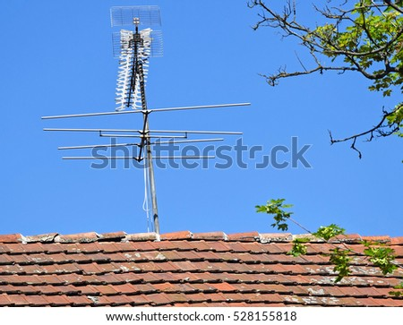 Television Antennas On The Roof Of A Building