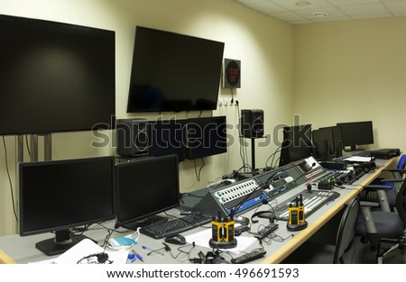 Television Broadcast Gallery.  Wide shot of vision mixing panel in a television gallery.  button on the control panel television equipment