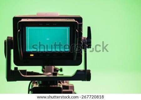 Television Camera in a green screen studio  - stock photo