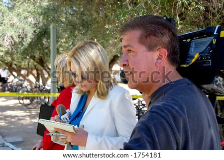 Television news team at work - stock photo