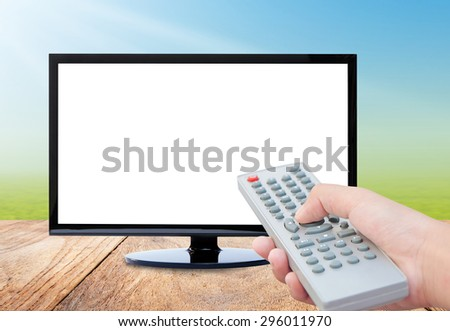 Television on wood floor and remote control TV  on nature background