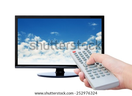 Television remote control watching tv , Sky background - stock photo