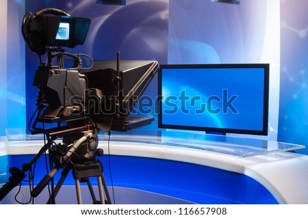 Television studio with camera and lights - stock photo