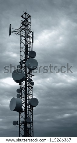Television tower against overcast sky