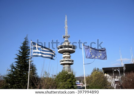 television tower and greek and europe flags