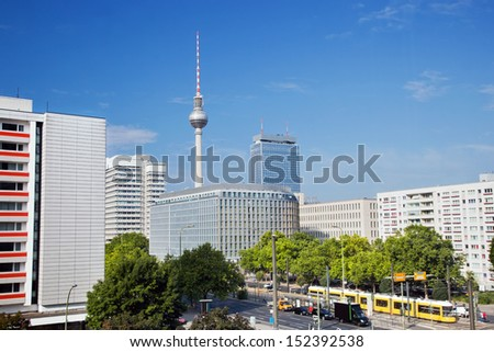 Television tower, German Fernsehturm seen from the eastern part of Berlin near Alexanderplatz. - stock photo