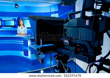 television woman announcer at studio during live broadcasting - stock photo