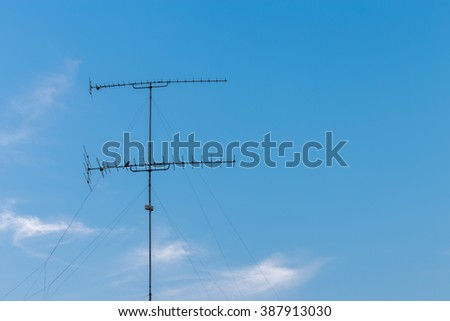 televisions antennas with  cloudy and blue sky background