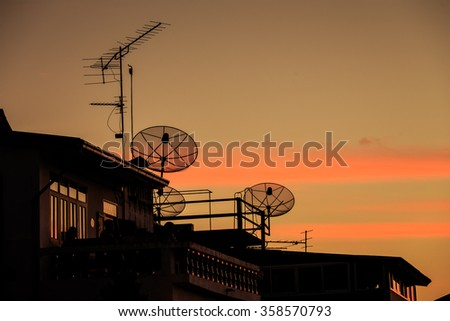 televisions antennas with sunset gold cloudy sky background