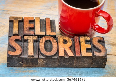 tell stories word abstract - text in vintage letterpress wood type with a cup of coffee - storytelling concept - stock photo