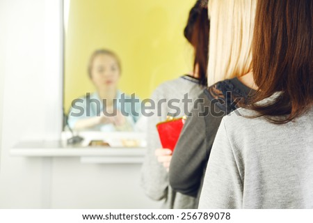 Teller window with working cashier  - stock photo
