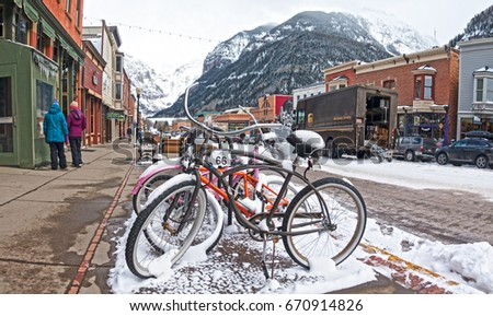 TELLURIDE, COLORADO/USA - FEBRUARY 2017: Snow Covered Bikes Parked on W Colorado Ave in Telluride