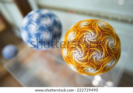 "Temari balls are a folk art form that originated in China and was introduced to Japan around the 7th century. ""Temari"" means ""hand ball"" in Japanese. Embroidered balls may be used in handball games. - stock photo"