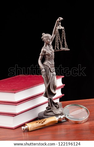 Temida statue on wooden table and black background - stock photo