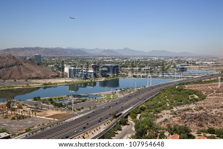 Tempe Town Lake with the Red Mountain Freeway (Loop 202) in the foreground - stock photo