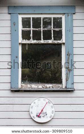 Temperature gage in Elfin Cove, Alaska - stock photo