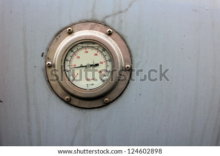 Temperature measurement installed into a metal tank - stock photo