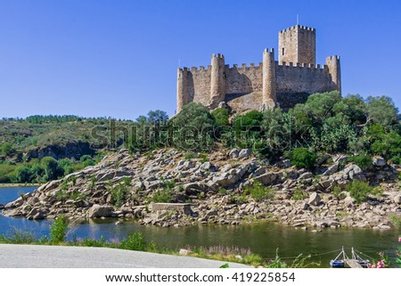 Templar Castle of Almourol. One of the most famous castles in Portugal. Built on a rocky island in the middle of Tagus river. - stock photo