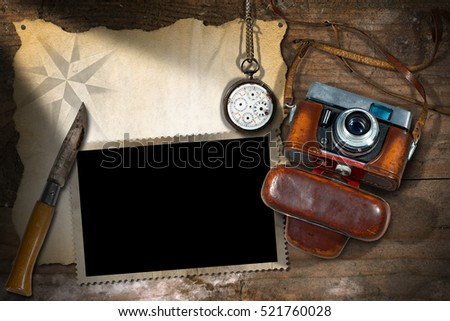 Template for adventurous travels. Old camera, empty parchment, photo frame, broken pocket watch and a pen knife