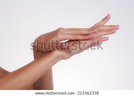 Template for skincare design. Perfect female hands preparing for apply some lotion. - stock photo
